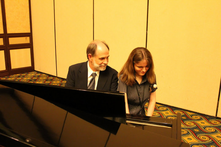 Photo of Grant with Rachel Flowers at Piano
