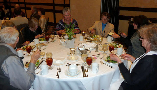 Photo of People at a table at the banquet