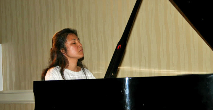Photo of Student Playing the Piano