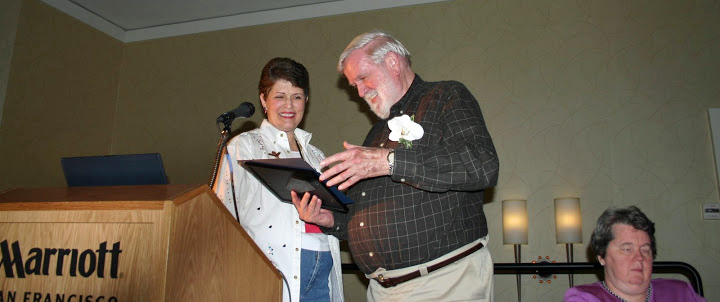 Photo of Christy giving award to Phil Hatlin